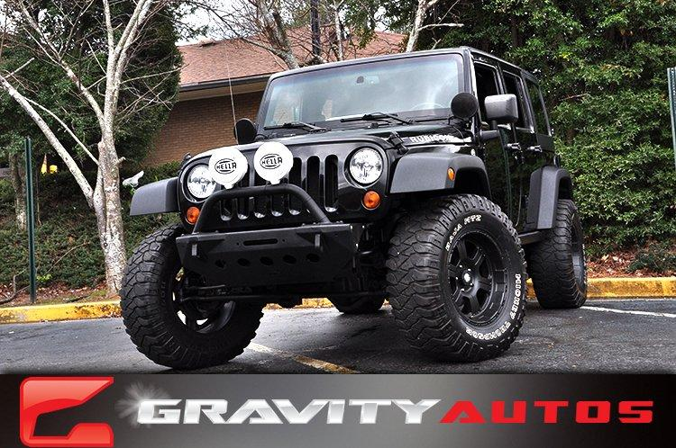 Used 2013 Jeep Wrangler Unlimited Rubicon for sale Sold at Gravity Autos in Roswell GA 30076 1